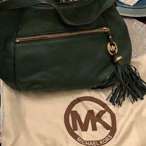 Dark green Michael Kors bag.